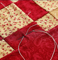 Tying, or tufting, is a quick alternative to hand- or machine-quilting. Tied quilts have a puffier look than those that are quilted. Here are some tips from All People Quilt in how to tie a quilt. Quilting For Beginners, Quilting Tips, Quilting Tutorials, Machine Quilting, Quilting Projects, Sewing Projects, Crazy Quilting, Sewing Tips, Sewing Basics
