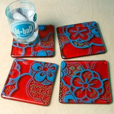 """kikuhandmade on Etsy4x4"""" silkscreened, fused glass coaster set of four. . The floral pattern is printed in turquoise on top of clear glass, then a mint green pattern fill is printed below - the entire pattern is cut.  The clear glass is then layered onto a fiery transparent red-orange."""