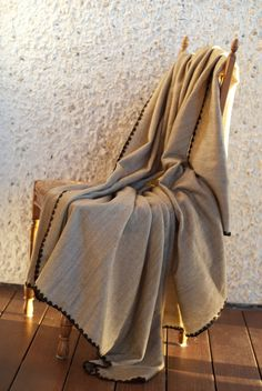 Paige Woven Throw - Tweed with Mocha Trim.  Made by artisans in Ecuador, it has the refined look and feel of cashmere.