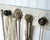 Love this idea? Use old spools, old door knobs, handles, whatever. The boards are readily available at craft stores, use them unfinished, apply stain, paint, stencil, or crackle finish! Use if for jewelry, belts,  scarves! Oh, the possibilities!