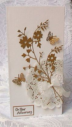 """By Viv. Die cut Bella Bouquet"""" (Memory Box) and butterflies Add doily, bow, and sentiment on white linen cardstock base."""