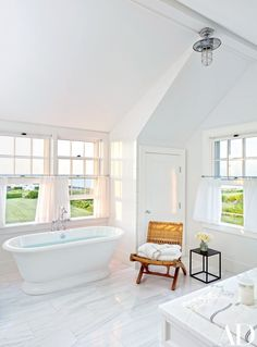 The master bath includes Waterworks tub fittings and curtains of a C&C Milano fabric from Holland & Sherry.