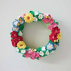 Spring wreath crammed with crochet flowers - someone make this for me!