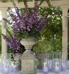 urns spilling with flowers... absolutely stunning party table decor