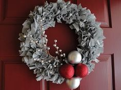 This is a gray fabric wreath with berries and red and silver ornaments Leslie Allison Designs on Etsy