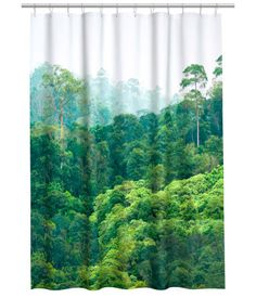 Shower curtain in water-repellent polyester with a printed photographic design and metal grommets at top. Shower curtain rings sold separately.
