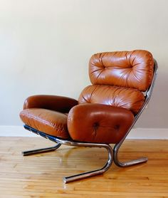 Milo Baughman; Chromed Metal and Leather Lounge Chair for Directional, c1970.