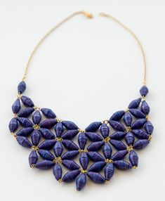 The intricate floral design of this statement necklace adds a special twist to your favorite paper bead accessories. Dressed up or down, this piece will attract attention however you wear it.