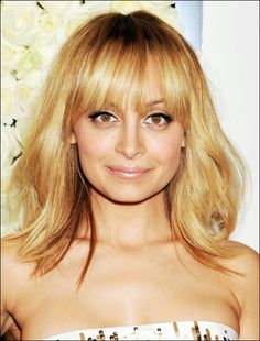 A long bob with heavy bangs can be a fun, easy hairstyle for any hair texture. More easy hairstyle ideas here: http://www.esalon.com/blog/8-alternatives-to-the-standard-ponytail/