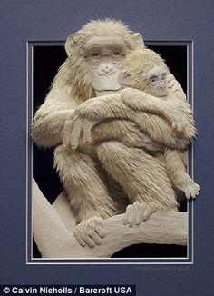 A paper sculpture of a Chimpanzee holding baby by artist Calvin Nicholls