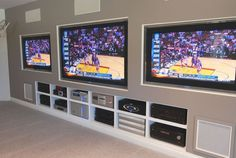 Traditional Home Theater with Built-in bookshelf, Carpet, High ceiling, Custom media cabinetry