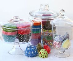 Kitchen Storage Ideas: Store colorful cupcake liners in glass jars for display and easy access.