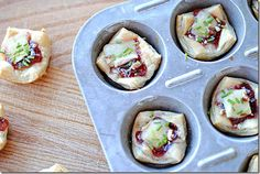 brie & cherry pastry cups by eat yourself skinny. this blog has SO many awesome, low calorie recipes.