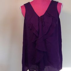 100% silk dark purple Quo-ta-tion top Gorgeous dark purple 100% silk sleeveless quo-ta-tion top. Ruffled front with tie. Light as air. Perfect for sunny days! quo-ta-tion Tops