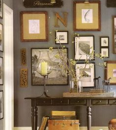 Eclectic wall from Pottery Barn.  Love Love Love.  Yes grey and brown is an awesome color scheme!