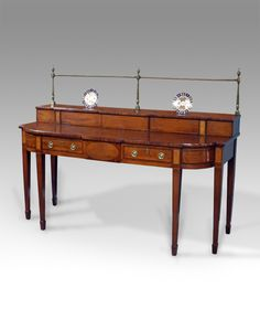 Sideboards - Fine George III mahogany breakfront serving table. The superstructure with brass gallery and ebony inlaid stringing, over four crossbanded drawers fitted with later brass handles and flanked by burr elm panels. Raised on square tapered legs terminating in spade feet.  circa. 1800