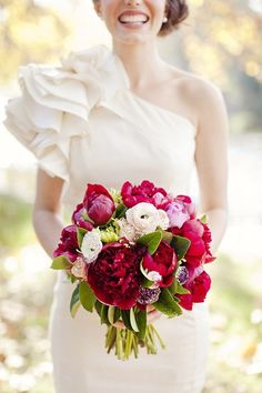 Real bride Rebecca being a florist herself put together this perfect union of hot pink peonies, pale pink ranunculus with such color contrast that will add vibrancy to any wedding.  Floral arrangement by Fox & Rabbit Beautifully photographed by Angela Higgins