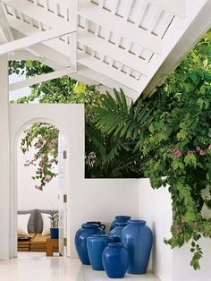 """R. Lauren - Guesthouse: In 1996 the couple purchased a beach house just down the hill and renovated it. They named it the White Orchid. The interior courtyard. """"The great house has a classic feel,"""" says Ralph Lauren. """"The White Orchid is clean, barefoot and luxurious."""""""