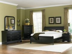 Black Bedroom Furniture, white bedding, and pillows to match the wall!