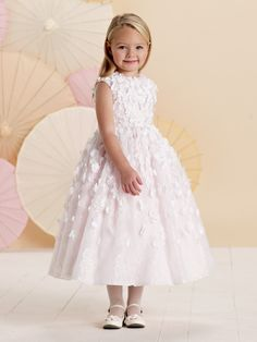 Sleeveless lace and satin tea-length A-line dress with jewel neckline, lace overlay bodice is encrusted with three-dimensional satin flowers and hand-beading, lace overlay gathered dirndl skirt features matching cascading flowers, suitable as a flower girl or party dress. Sizes: 2 – 14