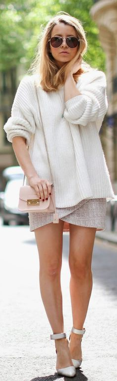 Caroline Louis is wearing a creme knitted sweater with a mini skirt, &Otherstories heels and a baby pink Furla mini bag