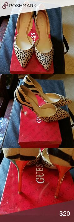 "Natural multi poney print pumps These double styled leopard print pumps have gold heels measuring 4 "". Minimal wear size 8.5 Guess Shoes Heels"