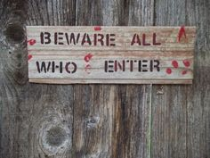 Beware All Who Enter, such an ominous warning! Bloody weather worn sign even has fingerprints left by someone. Someone trying to escape? or someone trying to hunt the victim? Comes ready to hang with cording. Approx. 15x5 ¼.  Each sign is hand painted on naturally distressed, reclaimed, salvaged and/or chipped old wood (which was destined for, but saved from the dumps). Each comes with cording or saw tooth hanger for hanging.  This is for the Beware All Who Enter sign only. Other photos are…