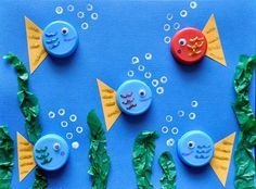 Bottle Cap Fish Use old bottle caps or milk caps to make an adorable ocean scene. Its a fun way to create using materials that might otherwise be thrown away. The post Bottle Cap Fish was featured on Fun Family Crafts. Kids Crafts, Animal Crafts For Kids, Family Crafts, Summer Crafts, Diy For Kids, Craft Projects, Arts And Crafts, Button Crafts For Kids, Recycling Projects
