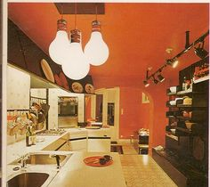 Change the flooring and wall color and it's contemporary. The flat front cabinets in white and the dark wood shelving are cool mod. Mid-century Interior, Vintage Interior Design, Vintage Interiors, Interior Design Kitchen, Interior Decorating, Retro Design, Kitchen Decor, 1970s Kitchen, Retro Kitchens