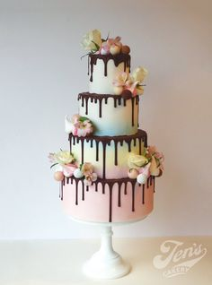Ombre wedding cake with chocolare drips, truffles and meringues, at Hampton Court Palace, West London