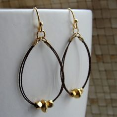 I love these earrings.  The dark brown silk is perfect with the gold. $28