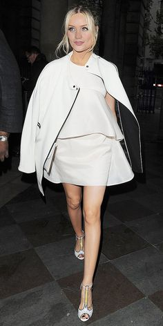 Leaving the Esquire summer Party in London.  Alice McCall Sacred Springs Dress ($349) Sophia Webster Dixie Doodle Pencil-Print Leather T-Strap Heels ($650)  Alternatives: Michael Kors Hooded Long Jacket ($135) MSGM Ruffled Shift Dress ($225) Gianni Bini Kelli T-Strap Platforms ($70)