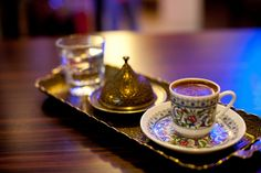 Turkish coffee is traditionally  offered together with water and sugar on the tray.