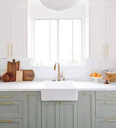 How to style your kitchen with two tone kitchen cabinets! Browse through 13 different two tone kitchen cabinets for the ultimate kitchen cabinet inspiration. For more paint and kitchen decorating ideas go to Domino. Two Tone Kitchen Cabinets, Green Cabinets, Painting Kitchen Cabinets, Kitchen Redo, New Kitchen, Kitchen Dining, White Cabinets, Kitchen Paint, Kitchen Ideas