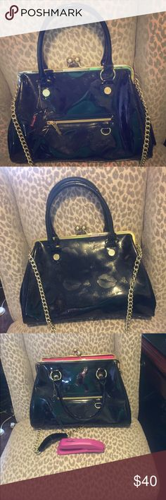 Besteyville Betsey Johnson Black Vinyl purse Black vinyl purse with pink interior. Handle and long strap. Such a classy and fun purse!  Used a few times in perfect condition. No tears or scuffs. Betsey Johnson Bags Shoulder Bags