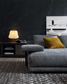 Horizontal arm detail of Bristol sofa in 412 cemento Rabat removable fabric, cushions in 1403 ocra.