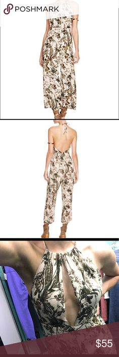 Free people twisted halter pantsuit one piece Free people pantsuit. In a really pretty neutral/green floral color. Size 0, purchased from a local thrift store but have never worn it yet, seems brand new. Just trying to make back the money that I paid for it! Free People Pants Jumpsuits & Rompers