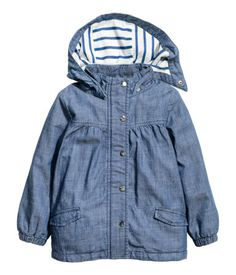 Denim blue. Parka in woven fabric with a detachable, lined hood. Stand-up collar, zip and wind flap at front with snap fasteners, gathered yoke at front,