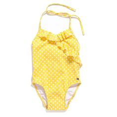 "Tommy Hilfiger little girls' swimwear. Suits her perfectly. Our swimsuit covers all bases with a dot print, halter tie and a bit of frill. Sorry, not available in ""Mommy"" sizes.• 90% nylon, 10% Spandex. Lining 100% synthetic.• Halter tie, fully lined, tiny Tommy flag on hem.• Machine washable.• Imported."