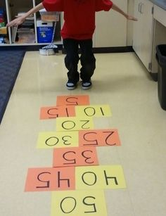 Skip Counting Hop Scotch- going to do this for 100th day; great for multiplication songs too!
