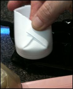"""Baby booties party favor made from Styrofoam cup. Cut top off cup. Cut 2 slits in cup 1"""" apart, push middle section between two slits back, fold sides over middle, secure by staple and glue pink or blue bow over staple. Netting into bootie to hold goodies."""