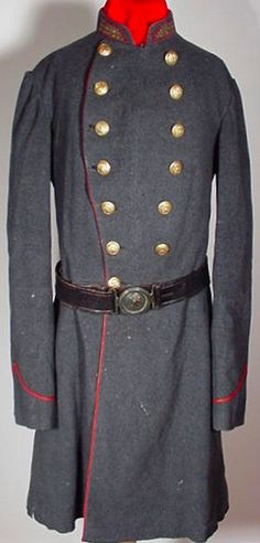 Artillery Officer's Frock Coat. The cadet gray, double breasted officer's frock coat is piped in red for the Artillery branch of service. There are three rows of gold braid on each collar denoting the rank of Captain. Louisiana state seal buttons with Horstmann back marks adorn the breast, the cuffs and the tails. Based on other surviving examples of the Washington Artillery's uniforms, it is almost certain that this coat was worn by a Captain of the elite Washington Artillery of New…
