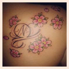 My beautiful cherry blossom tattoo with the libra sign in the middle and my brother's initial