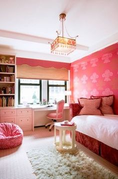 girl's rooms - red settee daybed red pillows pink chair built-ins desk bookcases pink bean bag flokati rug roman shade pink cornice box red paint pink stencils