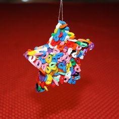 Julehjerte af hama-perler. Bland perler med masser af olie. 2 lag i form. Bag i 10 min ved 200 grader.