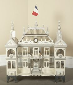 I love this cream bird cage with the French flag at the top of the cage. Paris flea market is the source for all things French.