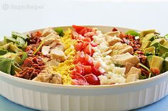 Cobb Salad ~ Classic American Cobb salad, a composed salad with bacon, avocado, chicken breast, tomato, hard boiled egg, chives, arranged on a bed of romaine, Boston, frisee lettuce and watercress. ~ SimplyRecipes.com
