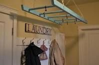 Need hubby to build something like this on the ceiling for hanging clothes in my new laundry room!