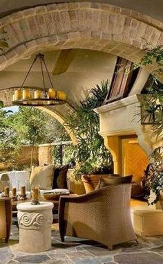 Beautiful Covered Patio...Love the brick archway & stunning stone fireplace