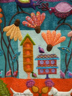 """""""Duncan's Garden Party"""" by Karolyn """"Nubin"""" Jensen.  Inspired by Sue Spargo.  2014 AQS show. Photo by Quilt Inspiration."""